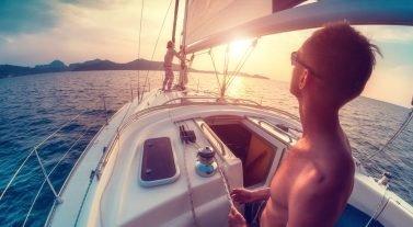 adjusting sails at sunset