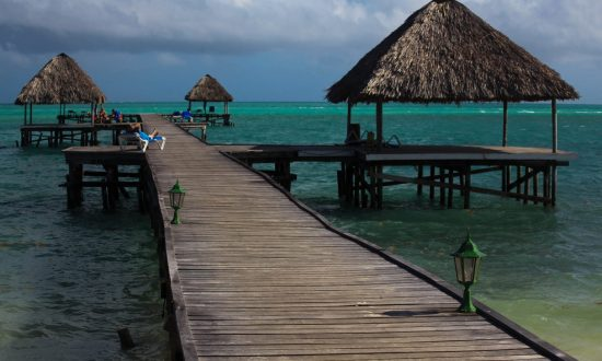 long dock with huts in the water