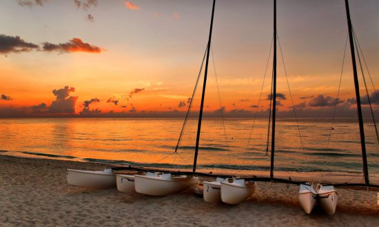 boats at the beach in sunset