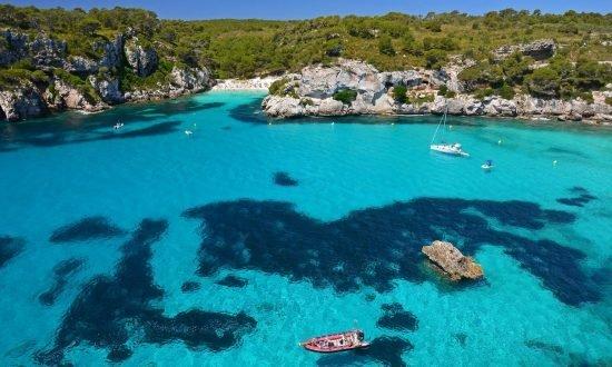 boats and hidden beach in the Balearic Islands