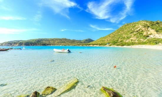 motorboat in the shallow water of Sardinia