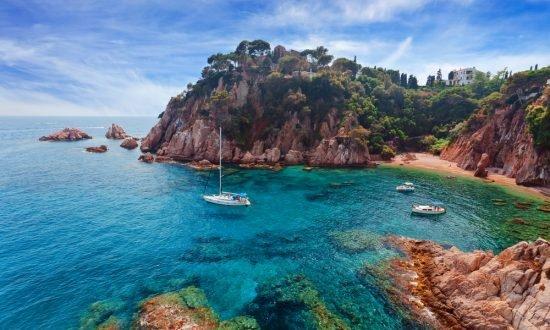 boats off the coast near beach of Spain