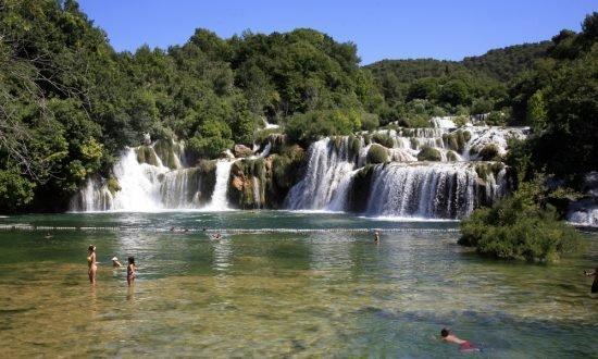 swimming in the waterfall in Croatia
