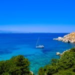 Boat in the water of the coast of Sardinia