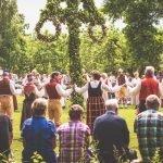 People dancing around Maypole at midsummer