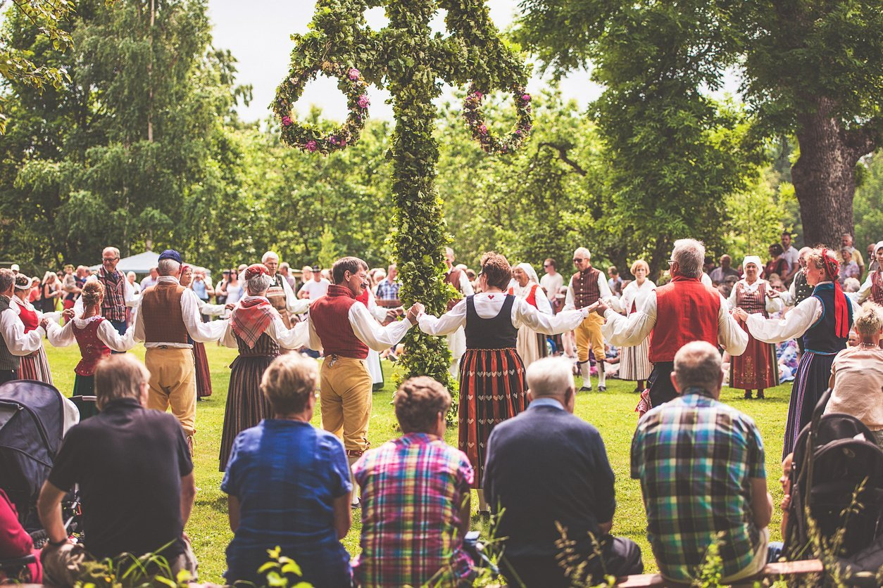 Dancing around the maypole at Midsummer