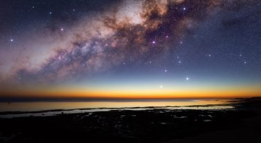 Starry night above the ocean