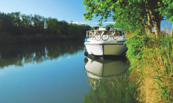 Canal boat on river - Canal cruises in Europe by Dream Yacht Charter