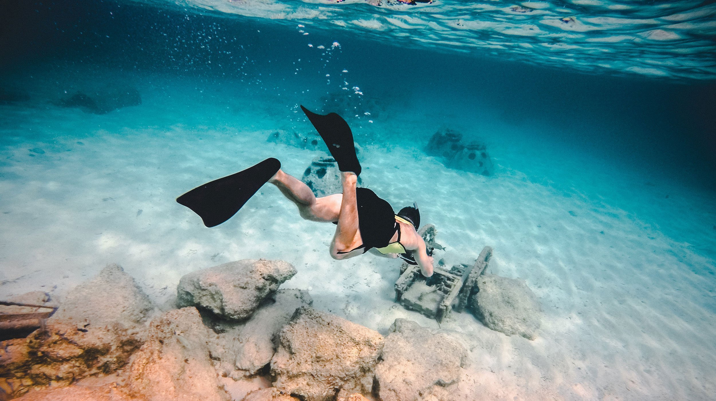 man snorkeling underwater in Mediterranean