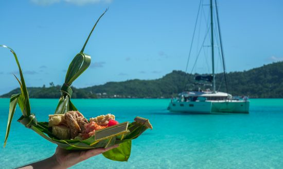 Local food with yacht in background