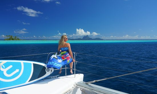 Guest on yacht looking at Tahiti islands