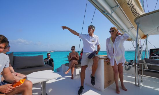Captain talking to guests on yacht