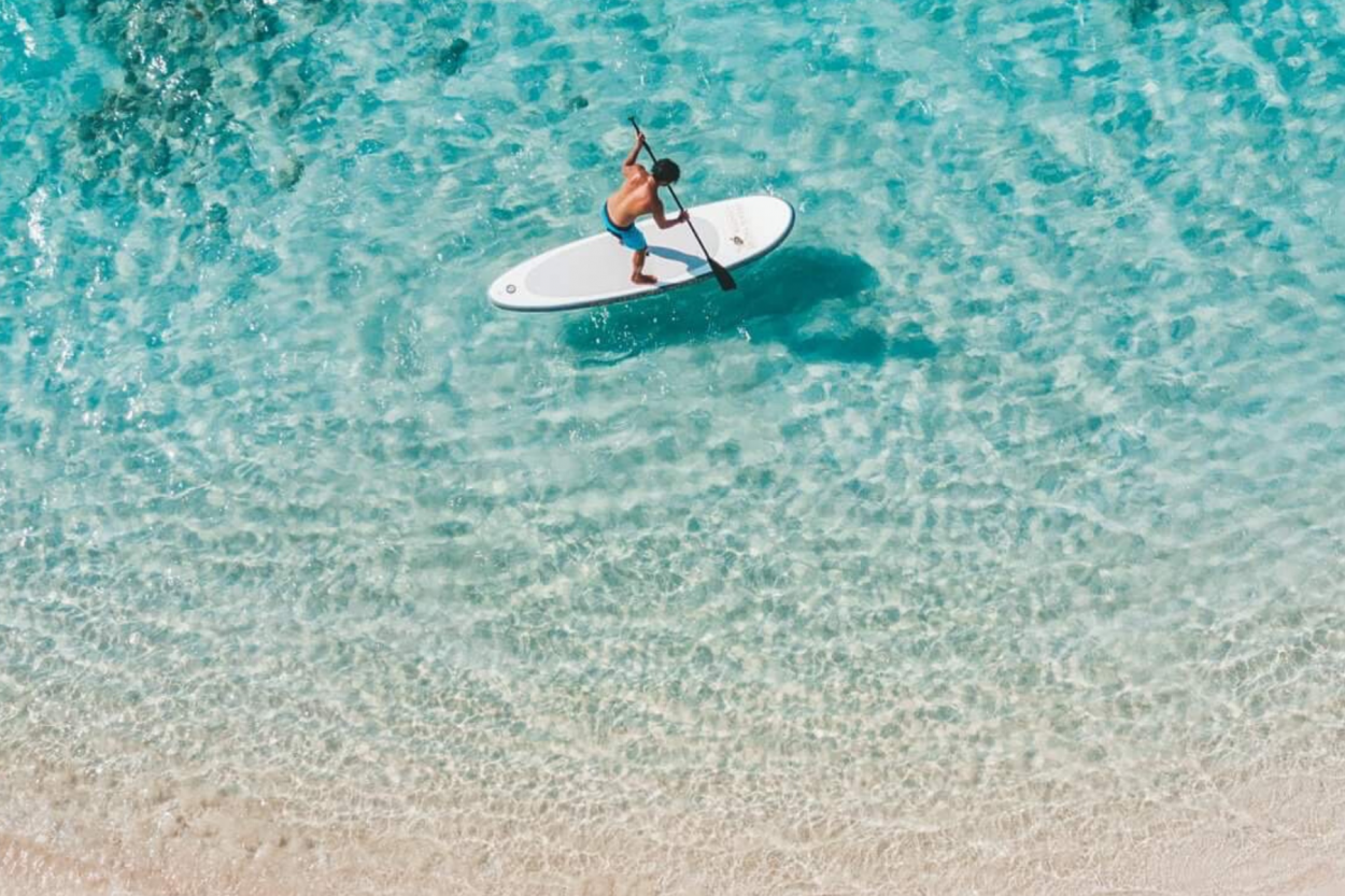 paddleboard turquoise water