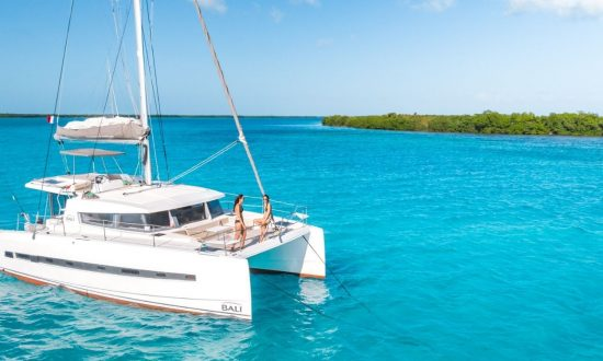 Guests relaxing on a boat sailing Cuba