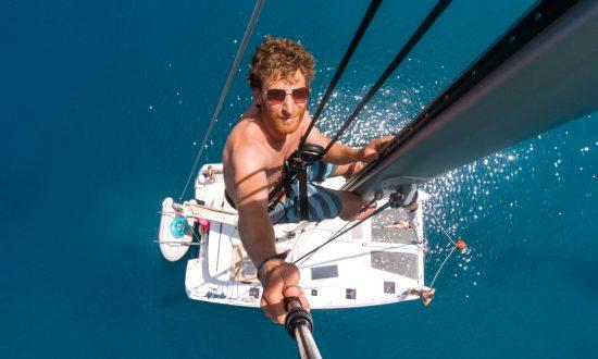 man at top of mast