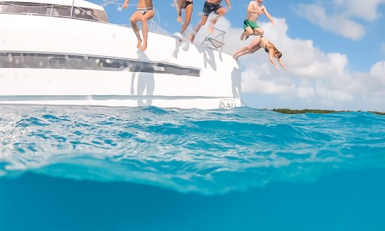People jumping into sea