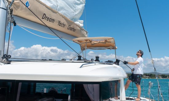 raising sails on yacht