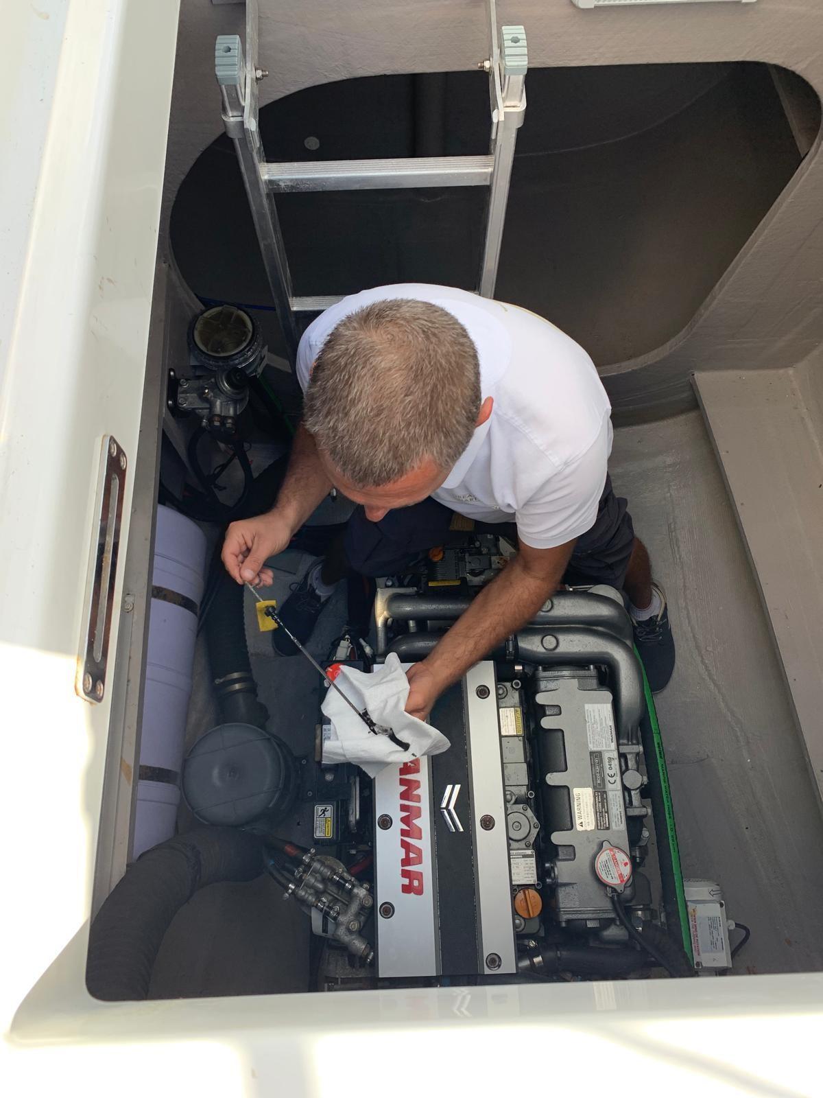 Marine mechanic fixing engine
