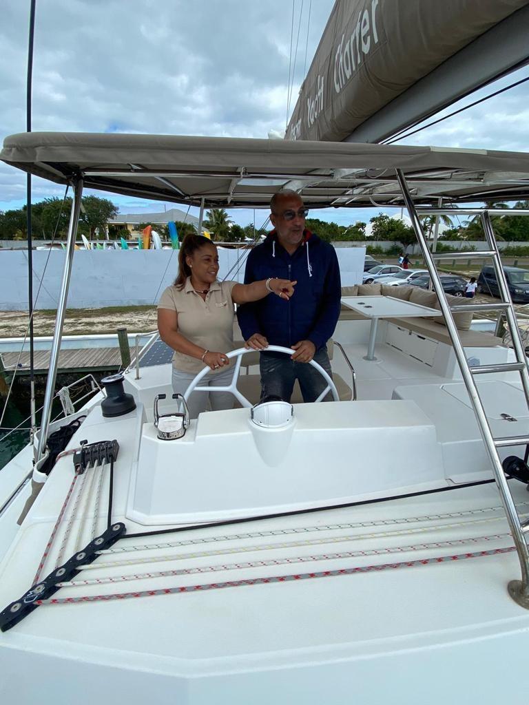 Intern at helm yacht